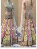 VandV Beige Colour Designer Net And Brocade Bridal Lehenga Choli