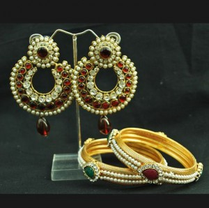 Buy Stone studded Maroon earrings with pair of Pearl Bangles Online