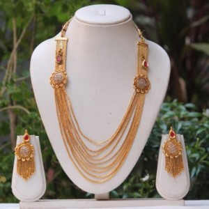 Buy Royal Ad Stone Round pendant and Maroon kundan chain necklace set Online